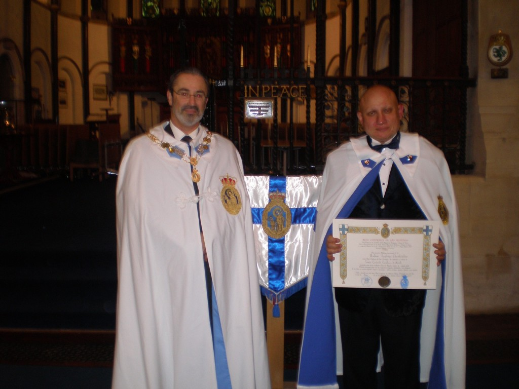 Andrew Charalambous invested by the Royal Confraternity of Saint Teotonio pictured with HE Ulisses Pauleta Rolim, Count of Rolim and Reigada
